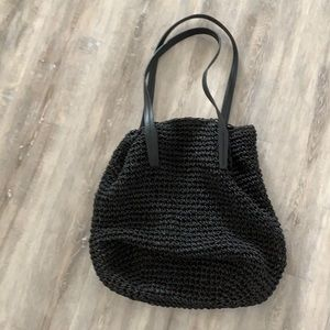 Cute woven raffia tote with faux leather handles